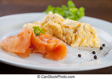 Salmon and scrambled eggs - Tasty dish of salmon with...