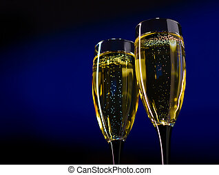 Two Glasses of Champagne on Dark Blue Background - Two...
