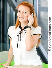 Portrait of young woman speaking on mobile phone