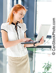 Pretty young woman working on computer