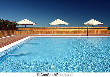 pool with umbrellas