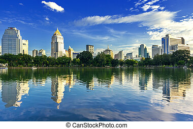View of the city and lake. - Garden in the city the daytime,...