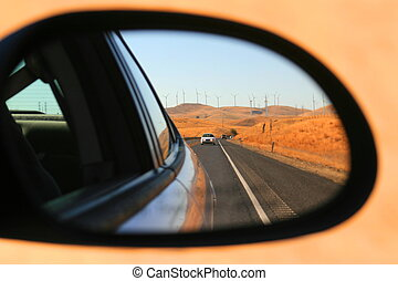 Side Mirror View - Side mirror view of a speeding car