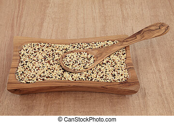 Tricolour Quinoa - Tricolour quinoa grain in an olive wood...