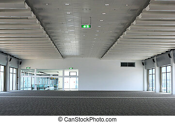 Empty hall of business building with lights