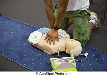 heart massage - First aid training. Demonstrating CPR on a...