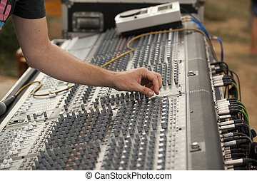 hand over music mixer - Adjusting of sound board