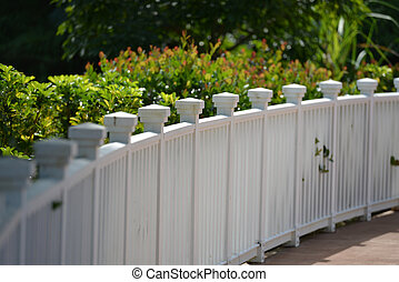 White Picket Fence - White picket fence with green grass...