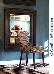 Home interior with design chair and mirror