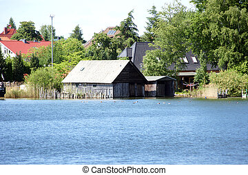 Boat house - The photograph of a boat shed at the lake Mritz...