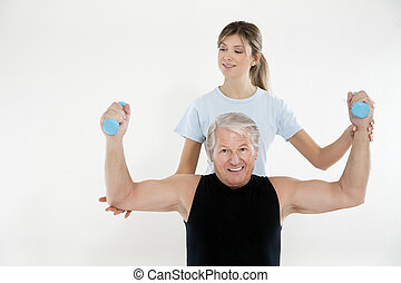 fitness and yoga - senior man exercising in gym. Copy space