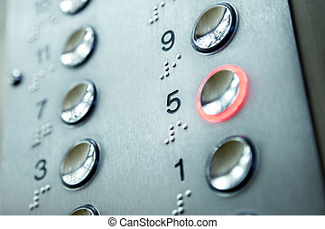 elevator keypad - close up of elevator keypad with glowing...