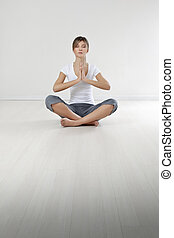 fitness and yoga - young woman doing yoga indoors. Copy...