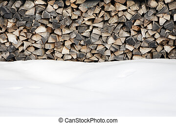 woodpile after snowing Copy space