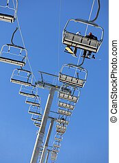 ski lift - people on ski lift. Low angle view