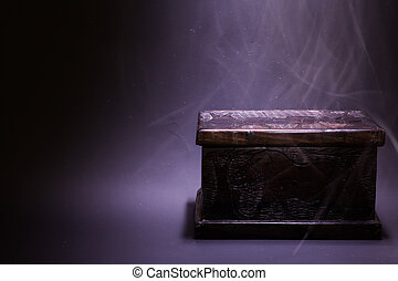Black Box - Ancient African box made of wood with light from...