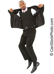 Attractive excited black businessman jumping with clipping path.
