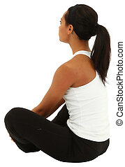 Beautiful black woman in yoga pose over white background...
