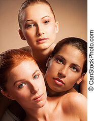 blond, red, and Latino together in beauty portrait