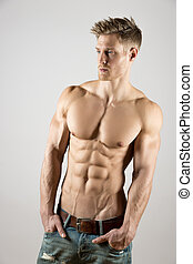young body art athlete with well trained pecs and abs...