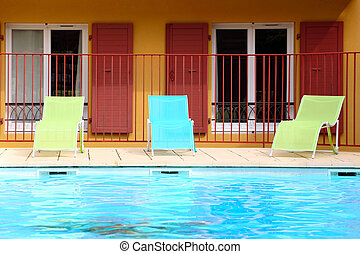 chaise longue near the open-air swimming pool