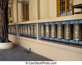 Prayer wheels - A row of Prayer wheels at the Monastery of...