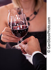 Close-up Of Couple Toasting Wine - Close-up Of Couples Hand...