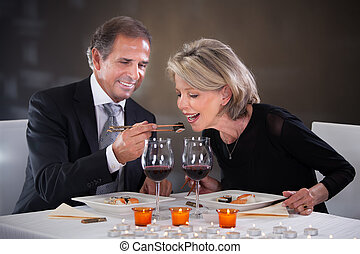Affectionate Couple In Restaurant - Romantic Mature Couple...