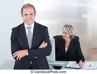 Confident Businessman - Happy Businessman Standing In Front...
