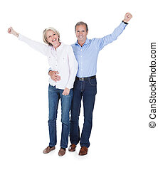 Portrait Of Mature Couple Enjoying Success - Happy Mature...