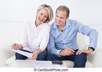 Portrait Of A Couple Enjoying Success - Portrait Of A Couple...