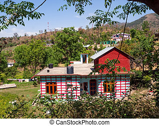 Dharamsala - House with red lines on the hill near...