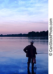 Fisherman at Dnieper river amazing clouds