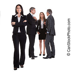 Businesswoman Standing In Front Of Her Colleagues Over White...