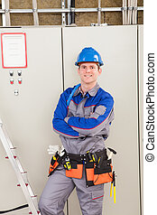 Young Worker Man With Hard Hat Leaning On Ladder