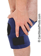Close-up Of Man Wearing Knee Brace - Close-up Of A Man...