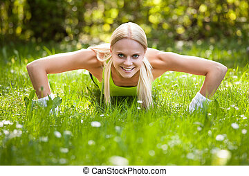 Young Blonde Woman Doing Push Ups