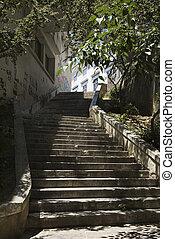 Sun dappled steps. - Sun dappled outside steps in Lisbon,...