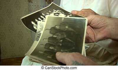 Old pictures in the hands of the elders