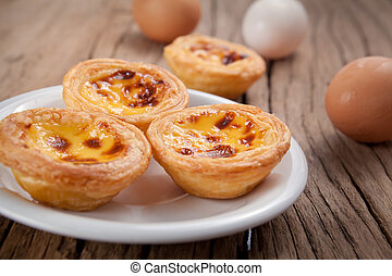 Portuguese egg tart - delicious portuguese egg tart on wood...