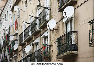 Apartment satellite dishes. - Apartment building with...