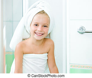 Cute little girl washing in bath