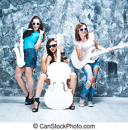 female rock band. girls with musical instruments: guitar,...