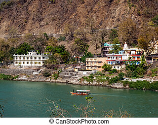Holy Ganges river - Small passenger boat in Ganges river...