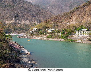 Holy Ganges river that flows through Rishikesh (the world...