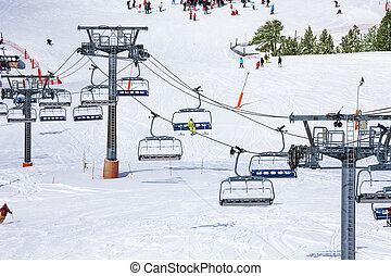 Ski lift background - Ski lift and skiers on the background