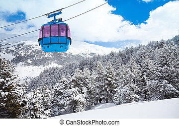 Closeup of ski lift cable car and forest covered with snow...
