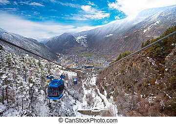 Encamp town in Andorra and cable car for lifting skiers and...
