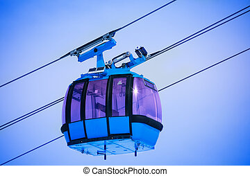Close up of cable car - Close-up of cable car over the blue...