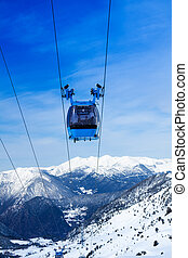 Front view of ski lift cable car with valley and mountains...